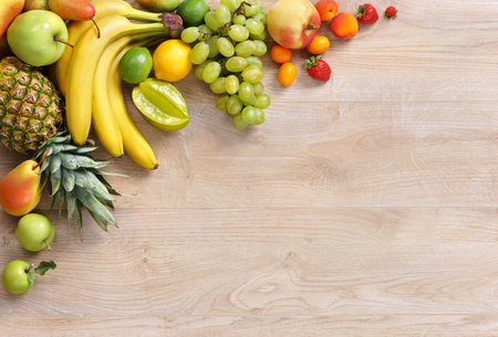 eating fruits: Healthy eating background, studio photography of different fruits on wooden table. High resolution product. Stock Photo