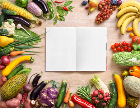 nutrients: Purchase list. Space for text, studio photography of open blank ring bound notebook surrounded by a fresh vegetables and pencil on old wooden table