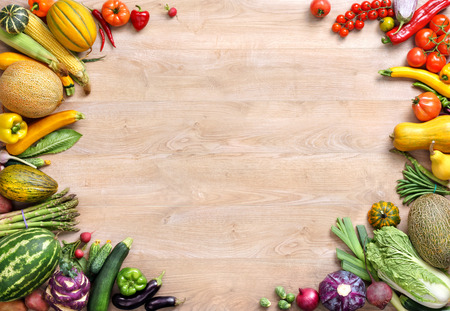 ripe: Healthy food background, studio photo of different fruits and vegetables on wooden table Stock Photo
