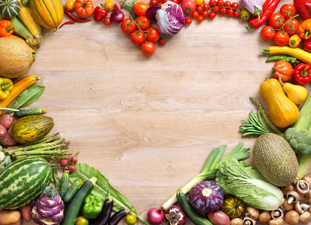 biology backgrounds: Heart shaped food, food photography of heart made from different fruits and vegetables on wooden table