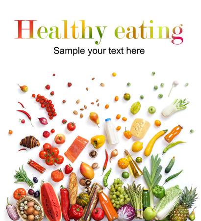 白い背景で背景、さまざまな果物や野菜のスタジオ撮影を食べる健康