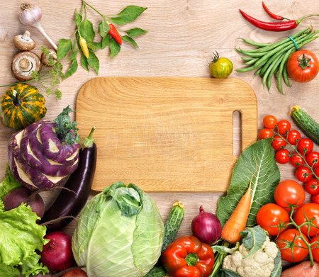blank space: Healthy food background and Copy space, studio photography of open blank ring bound notebook surrounded by a fresh vegetables and pencil on old wooden table