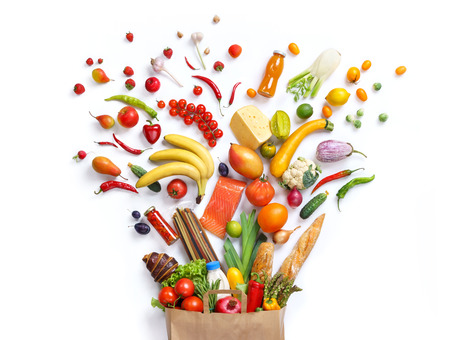Healthy eating background, studio photography of different fruits and vegetables on white backdrop. Healthy food background, top view. High resolution product, Stockfoto