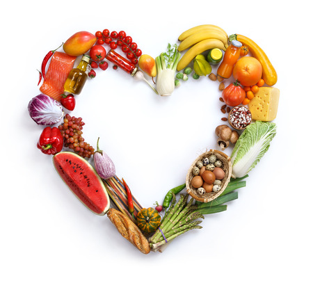 fruits background: Heart symbol, studio photography of heart made from different fruits and vegetables - on white background. Healthy food background, top view. High resolution product,