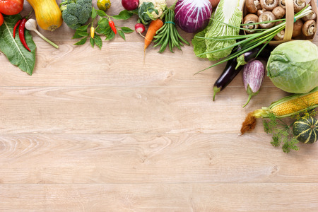 vegetable plants: Healthy food on wooden table. Top view with copy space high-res product, studio photography of different vegetables on old wooden table. Stock Photo