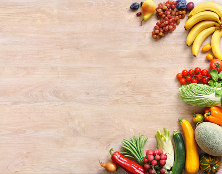 Healthy and Fresh vegetables and fruits on wooden table. Top view with copy space. high-res product, studio photography of different vegetables on old wooden table.