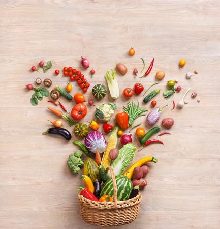 健康食品の背景。木製のテーブルで別の果物と野菜のスタジオ撮影 写真素材
