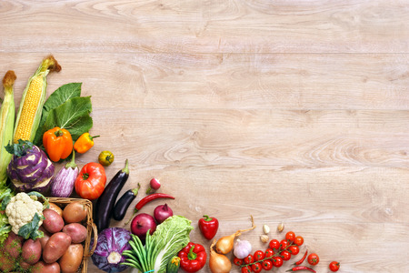Healthy eating background. Top view with copy space, high-res product, studio photography of different vegetables on old wooden table. Stock Photo
