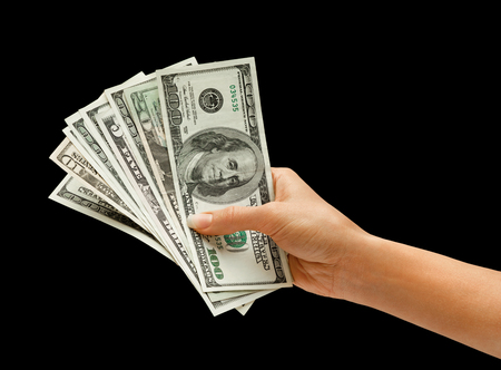 money in hand: Hand is giving money isolated on black background