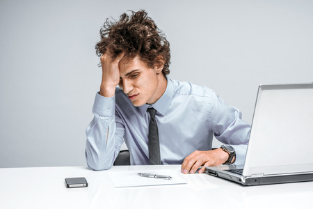 regression: Entrepreneur dissatisfied with his earnings, profit, income, gain, benefit, margin. Modern businessman at the workplace working with computer, depression and crisis concept