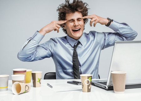 crisis management: Manager with gun wants to commit suicide  modern office man at working place, depression and crisis concept Stock Photo