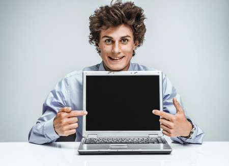 auditors: Young manager showing at screen laptop, modern businessman at the workplace working with computer