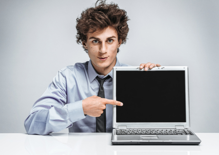 specify: Young businessman specify at screen laptop  modern businessman at the workplace working with computer