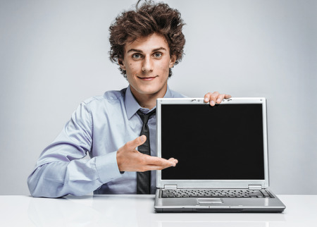 auditors: Young businessman showing at screen laptop  modern businessman at the workplace working with computer Stock Photo