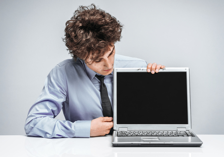 actuary: Cheerful manager looking at screen laptop. Modern businessman at the workplace working with computer. Business concept Stock Photo