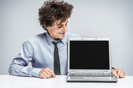 auditors: Cheerful manager looking at screen laptop  modern businessman at the workplace working with computer Stock Photo