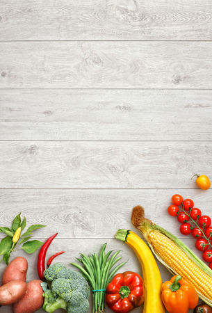 Healthy food background. Studio photo of different fruits and vegetables on white wooden table. High resolution product.