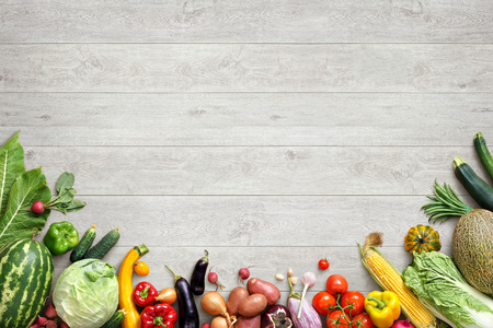 Healthy eating background. Studio photo of different fruits and vegetables on white wooden table. High resolution product.