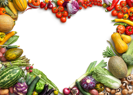 Heart shaped food. Food photography of heart made from different fruits and vegetables isolated white background. Copy space. High resolution product Foto de archivo