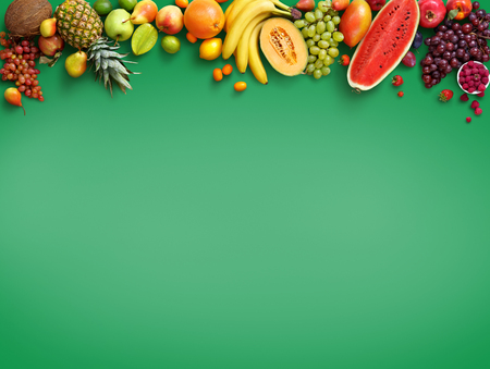 Organic food background. Photography different fruits isolated green background. Copy space. High resolution product