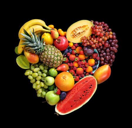 Deluxe Heart symbol. Fruits diet concept. Food photography of heart made from different fruits on black background. High resolution product.