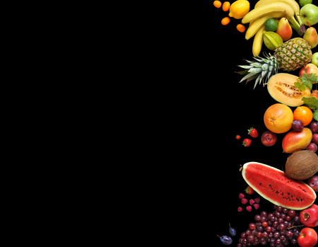 deluxe: Deluxe fruits background. Studio photography different fruits isolated on black background. Copy space. High resolution product Stock Photo