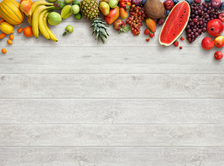 Healthy food background. Studio photo of different fruits on white wooden table. High resolution product. Stock Photo - 54088838
