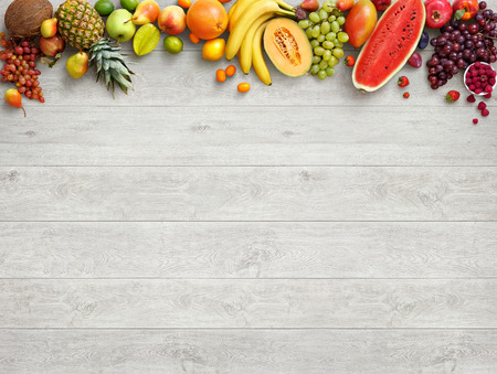 Healthy food background. Studio photo of different fruits on white wooden table. High resolution product. Stock Photo - 54088843
