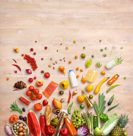 Healthy food background. Studio photo of different fruits and vegetables on wooden table. High resolution product, top view. Фото со стока