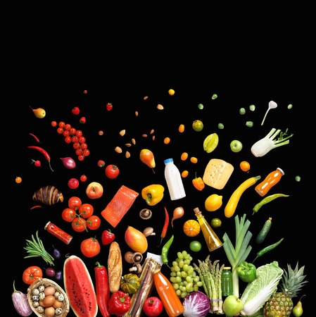 Deluxe food background. Studio photo of different fruits and vegetables isolated on black background, top view. High resolution product