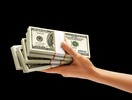 deposit: Hand holding Stacks of dollars isolated on white background. Business concept