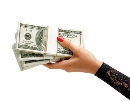 salarios: Womens Hand holding pilas de billetes de dólares aislados sobre fondo blanco. Concepto de negocio