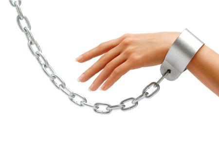 gefesselt: Womans hand in chains isolated on white background. Close up, concept against violence Lizenzfreie Bilder