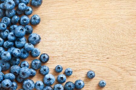 harvest background: Premium Blueberries on wooden background. Close up, top view, high resolution product. Harvest Concept Stock Photo