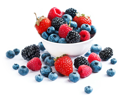 assorted: Ceramic bowl with assortment berries (blueberries, strawberries and blackberries) on white background. Close up, high resolution product. Harvest Concept