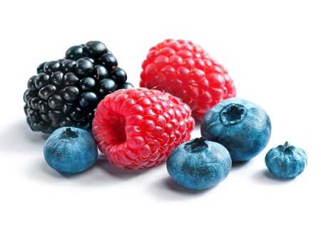 assorted: Berries blackberies, blueberries and raspberries on white background. Close up, top view, high resolution product. Harvest Concept