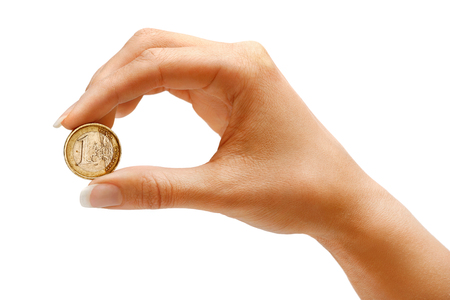women's hand: Womens hand holding a coin one euro on white background. Business concept