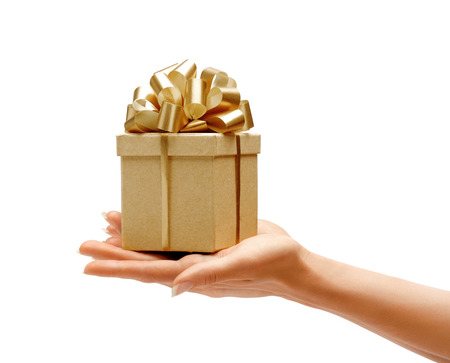 Hands holding gift box isolated on white background. High resolution product Stock Photo