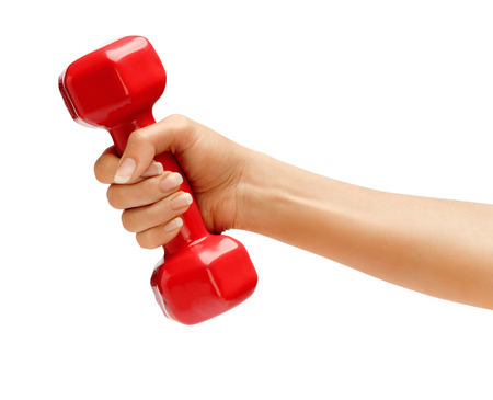 dumbells: Womans hand holding dumbbell isolated on white background. Close up, concept of healthy lifestyle