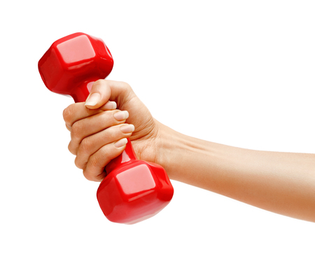 dumbell: Womans hand holding dumbbell isolated on white background. Close up, concept of healthy lifestyle