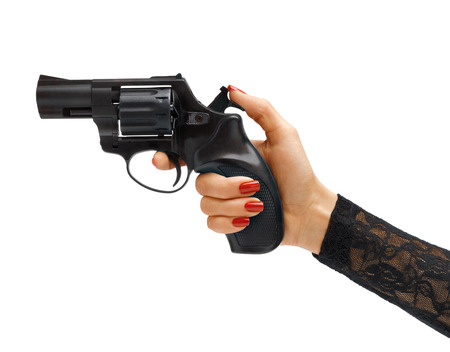 vindictive: Womans hand cocking revolver gun. Studio photography of womans hand holding handgun - isolated on white background. Business concept