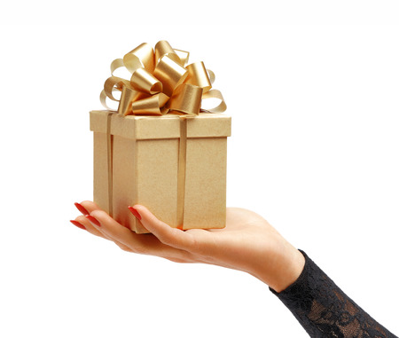 Women's hands holding gift box isolated on white background. High resolution product Archivio Fotografico