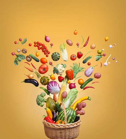 eating fruits: Healthy eating background. Studio photography of different fruits and vegetables on golden background, top view. High resolution product.