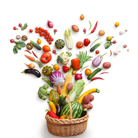 isoleted: Healthy food in basket. Studio photography of different fruits and vegetables isoleted on white backdrop, top view. High resolution product. Stock Photo