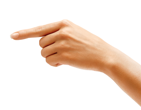 womans: Womans hand points a finger at something isolated on white background. High resolution product. Close up