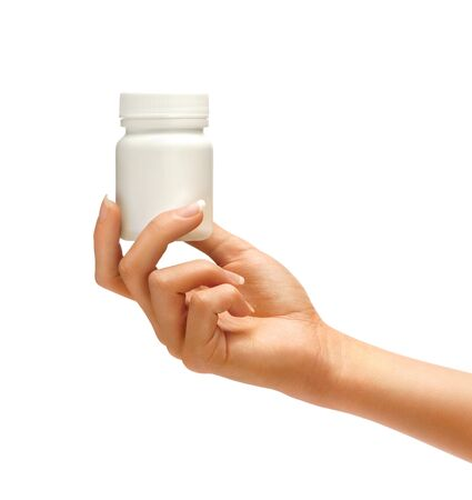 Female Hand is giving bottle for pills isolated on white background. Palm up, close up. High resolution product.