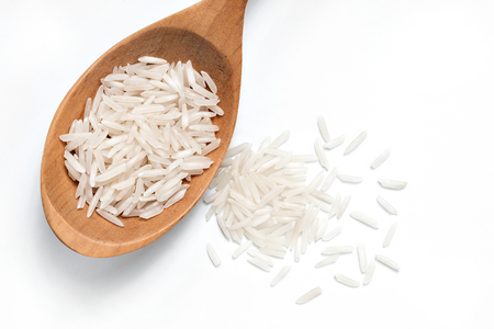 white rice: White Rice on a wooden spoon on white background. Close up, top view, high resolution product.