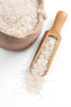 white rice: Rice in wooden spoon and sack on white background. Close up, high resolution product. Stock Photo