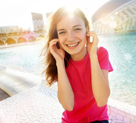 sciences: Student listening music on sunny day in City of Arts and Sciences, Valencia. Summer travel vacation in Spain