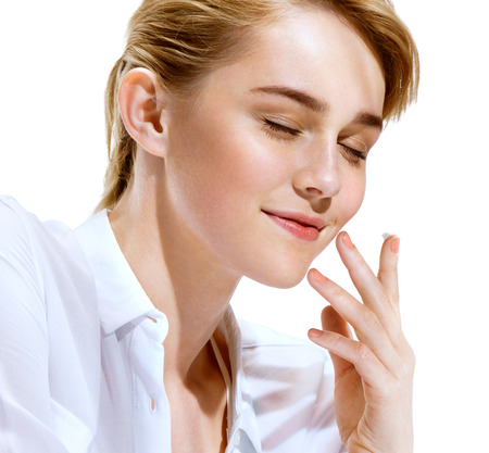 Beautiful sensual woman face. Close up of an attractive girl of European appearance on white background. Youth and skin care concept